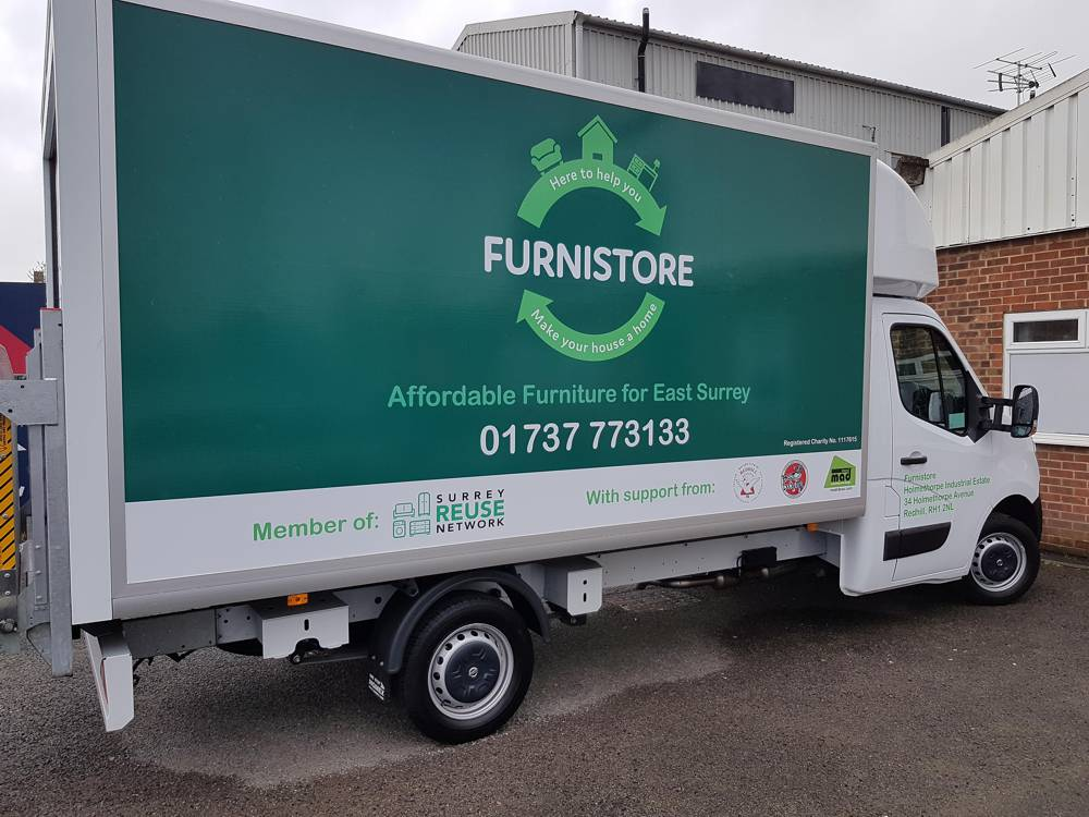 Using shop signage and vehicle graphics to promote your business